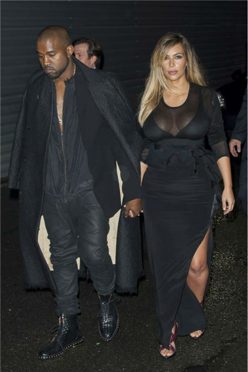 "<div class=""meta ""><span class=""caption-text "">Kim Kardashian and Kanye West attend the Givenchy Spring/Summer 2014 Ready-To-Wear Collection fashion show during Paris Fashion Week in Paris, France on Sept. 29, 2013. (Nicolas Genin / Abaca / Startraksphoto.com)</span></div>"