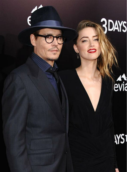 Johnny Depp and reported fiancee Amber Heard, who wore a diamond ring, appear at the premiere of the movie &#39;3 Days To Kill&#39; in Los Angeles on Feb. 12, 2014. It was reported in January that the two are engaged, although the pair has not confirmed this. <span class=meta>(Sara De Boer &#47; Startraksphoto.com)</span>