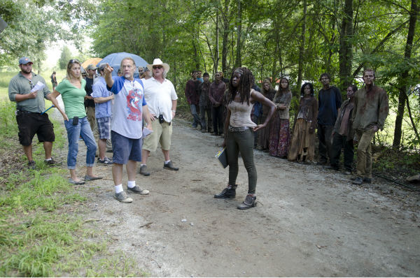 Co-xecutive Producer&#47;SFX Makeup Supervisor Greg Nicotero, Danai Gurira &#40;Michonne&#41; and actors dressed as Walkers appear on the set of AMC&#39;s &#39;The Walking Dead&#39;s season 4 midseason premiere, titled &#39;After,&#39; which aired on Feb. 9, 2014. <span class=meta>(Gene Page &#47; AMC)</span>
