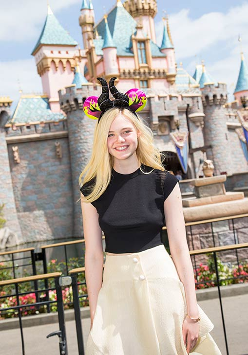 Elle Fanning poses at Sleeping Beauty Castle at Disneyland, in Anaheim, California on Saturday, April 12. She celebrated her 16th birthday on April 9.