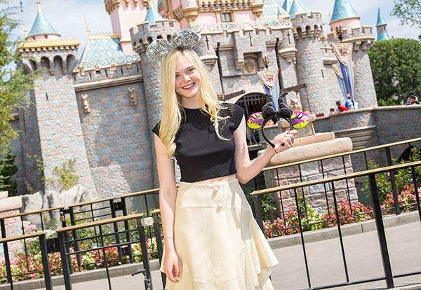 Elle Fanning poses at Sleeping Beauty Castle at Disneyland, in Anaheim, California on Saturday, April 12. She celebrated her 16th birthday on April 9. She plays Princess Aurora in the upcoming Walt Disney Pictures movie &#39;Maleficent,&#39; alongside main star Angelina Jolie. The movie opens nationwide on May 30. <span class=meta>(Paul Hiffmeyer &#47; Disneyland)</span>