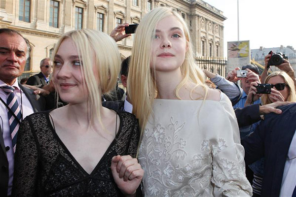 Actresses Dakota Fanning and Elle Fanning arrive at the Louis Vuitton Spring &#47; Summer 2014 fashion show during Paris Fashion Week on Oct. 2, 2013. <span class=meta>(Audrey Poree &#47; Abaca &#47; Startraksphoto.com)</span>