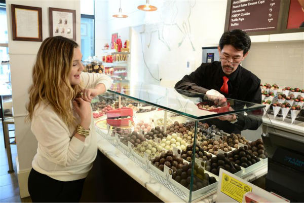 Drew Barrymore, who is pregnant with her second child, appears at a Godiva chocolate shop in Los Angeles on Jan. 29, 2014 to kick off a Valentine&#39;s Day partnership to promote her book &#39;Find It In Everything.&#39; OTRC.com has learned Barrymore picked these truffles from the display -- Salted Almond, Birthday Cake and Hazelnut Crunch Truffle. She said she was looking forward to sharing the chocolate with husband Will Kopelman. <span class=meta>(Michael Simon &#47; Startraksphoto.com)</span>