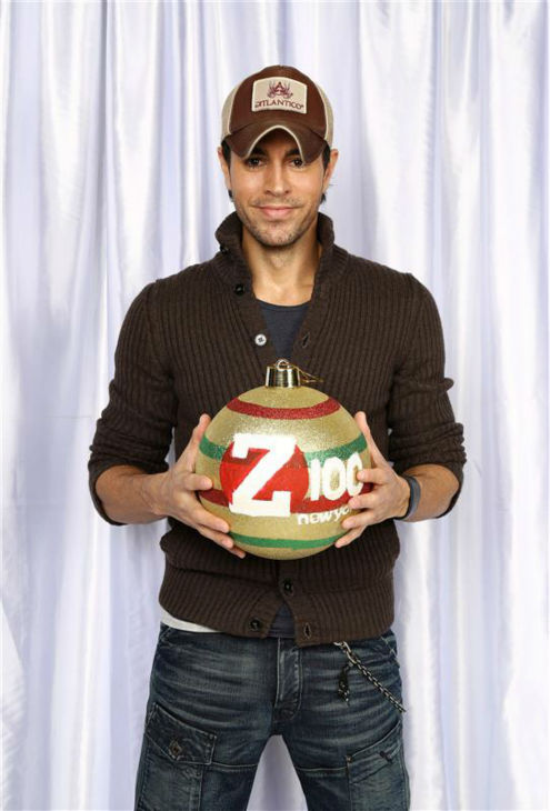 "<div class=""meta image-caption""><div class=""origin-logo origin-image ""><span></span></div><span class=""caption-text"">Enrique Iglesias poses in a holiday-themed photo booth at Z100's Jingle Ball 2013 on Dec. 13, 2013, just before Christmas. (Sara Jaye Weiss  / Startraksphoto.com)</span></div>"
