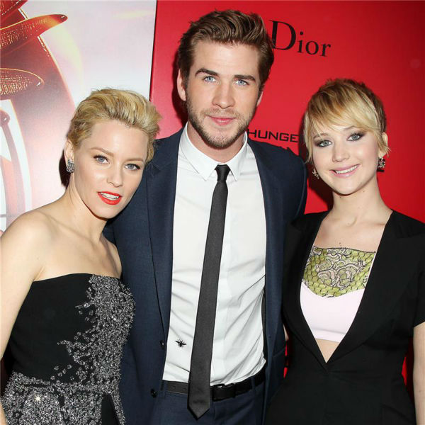 &#39;The Hunger Games: Catching Fire&#39; actors Elizabeth Banks &#40;Effie Trinket&#41;, Liam Hemsworth &#40;Gale Hawthorne&#41; and Jennifer Lawrence &#40;Katniss Everdeen&#41; attend the premiere of the movie in New York on Nov. 20, 2013. <span class=meta>(Dave Allocca &#47; Startraksphoto.com)</span>
