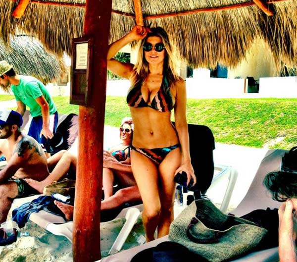 Fergie appears in a bikini in this photo she posted on her Twitter page on May 29, 2012 during a trip to Mexico and husband Josh Duhamel. Adios Cancun! she said. - Provided courtesy of t.co/4z9z5hng / twitter.com/Fergie
