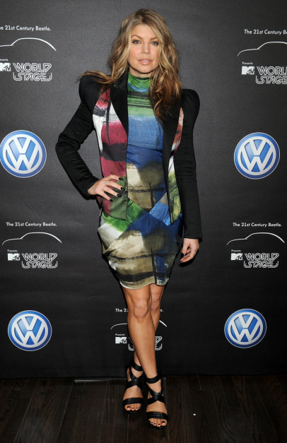 Fergie from the Black Eyed Peas poses before performing at the MTV World Stage in New York City on April 18, 2011 to celebrate the arrival of the 21st Century Beetle.