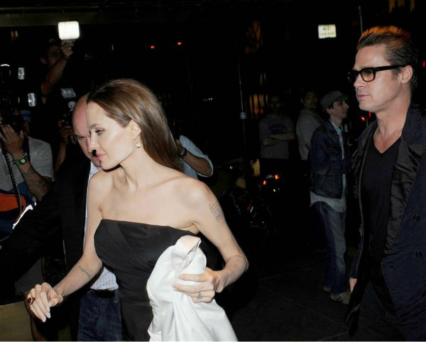"<div class=""meta ""><span class=""caption-text "">Angelina Jolie and Brad Pitt leave the premiere of the HBO film 'The  Normal Heart' in New York on May 12, 2014. (Humberto Carreno / Startraksphoto.com)</span></div>"