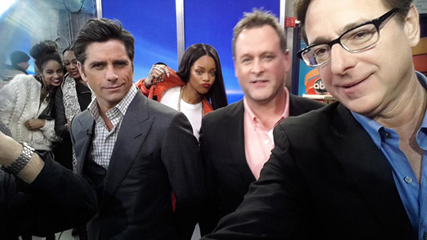 Rihanna photo-bombs 'Full House' stars John Stamos, Dave Coulier and Bob Saget on ABC's 'Good Morning America' on Jan. 29, 2014.