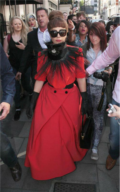 Lady Gaga walks on a crowded street in London on Sept. 9, 2012. Lady Gaga is in the British city as part of her tour.