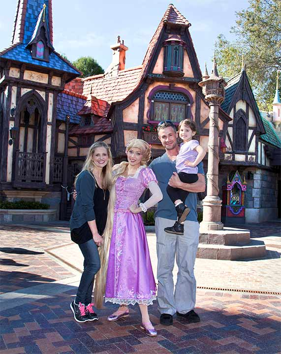 Sarah Michelle Gellar, Freddie Prinze Jr. and their daughter Charlotte, 3, meet Rapunzel at the all-new 'Fantasy Faire' attraction at Disneyland park in Anaheim, California on Wednesday, March 6, 2013.