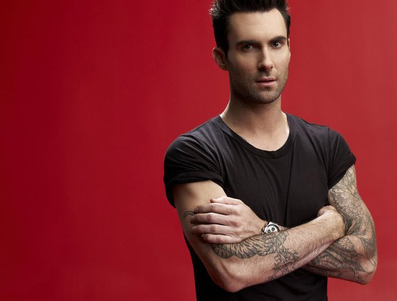 "<div class=""meta image-caption""><div class=""origin-logo origin-image ""><span></span></div><span class=""caption-text"">Levine expressed in a June 2012 interview with Details magazine why he never had a problem with talking to girls. 'One of my theories on why I'm so capable of understanding women is that after my parents split, my mom moved in with her brother's ex-wife - my aunt - who was also newly single,' he says. 'So I was living in a house with two jilted women, plus my cousin, who's more like my sister, and my brother, Michael, who we eventually find out is gay. Just the estrogen alone ... You know when you're 14 and terrified to talk to a girl? I didn't suffer much from that. It seemed very natural to me to talk to girls.' (Pictured: Adam Levine appears in a still 'The Voice' where he performed in 2012.) (NBC)</span></div>"