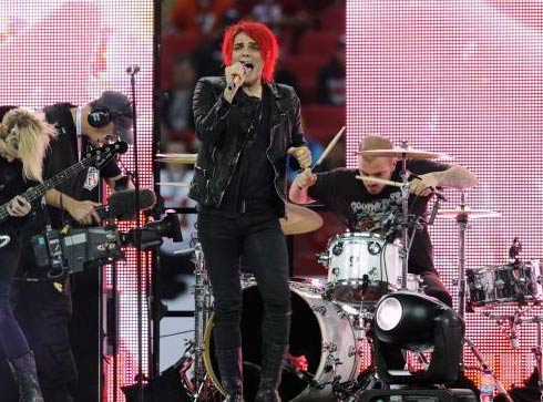 Gerard Way appears in a photo with his band My Chemical Romance from the NFL Wembley performance.