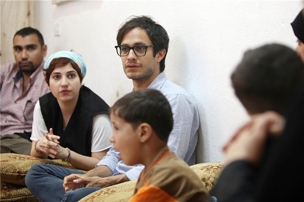 Gael Garcia Bernal visits a 15-member family of Syrian refugees who benefit from Oxfam NGO support, inside a four-room apartment in  in Beqaa, Jordan on Aug. 12, 2013.