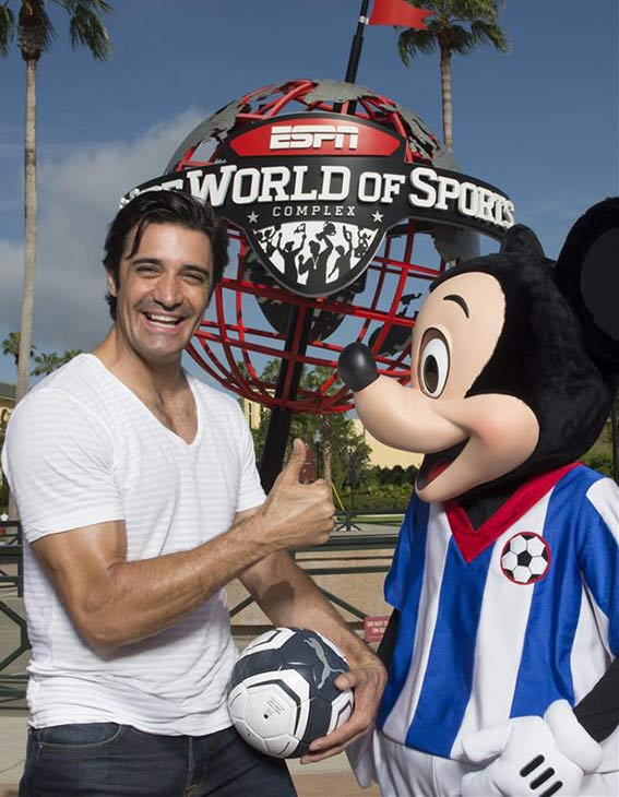 Gilles Marini poses with Mickey Mouse at ESPN Wide World of Sports at the Walt Disney World Resort in Lake Buena Vista, Florida on July 23, 2013.