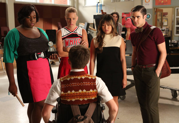 Unique (guest star Alex Newell), Brittany (Heather Morris), Tina (Jenna Ushkowitz) and Blaine (Darren Criss) ask Artie (Kevin McHale, bottom) to pick one of them as the next glee club star in the season 4 premiere episode of 'Glee' in 2012.