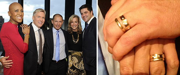 Sam Champion stands with Rubem Robierb on their wedding day on Dec. 21, 2012, along with 'GMA' colleagues Robin Roberts, Sam Elliot and Lara Spencer. /  Rubem Robierb Tweeted this photo of his and Sam Champion's wedding rings on Dec. 21, 2012.
