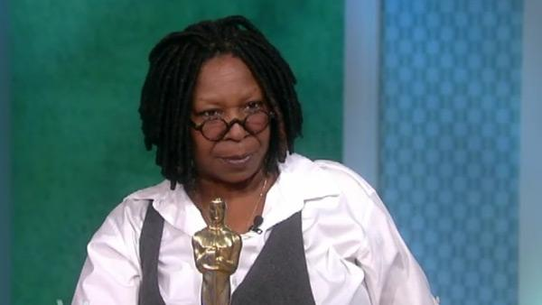 Whoopi Goldberg holds her Oscar in a Feb. 14,...