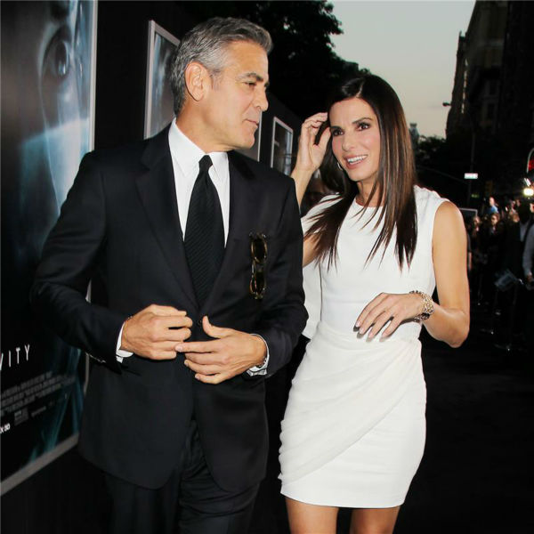 George Clooney and Sandra Bullock appear at the premiere of 'Gravity' at AMC Lincoln Square in New York on Oct. 1, 2013.