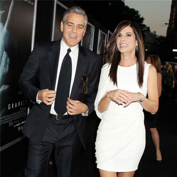 "<div class=""meta ""><span class=""caption-text "">George Clooney and Sandra Bullock appear at the premiere of 'Gravity' at AMC Lincoln Square in New York on Oct. 1, 2013. (Dave Allocca / Startraksphoto.com)</span></div>"