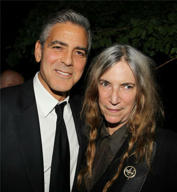 "<div class=""meta image-caption""><div class=""origin-logo origin-image ""><span></span></div><span class=""caption-text"">George Clooney and legendary rock singer Patti Smith appear at an after party following the premiere of 'Gravity,' at the Museum of Natural History in New York on Oct. 1, 2013. (Dave Allocca / Startraksphoto.com)</span></div>"