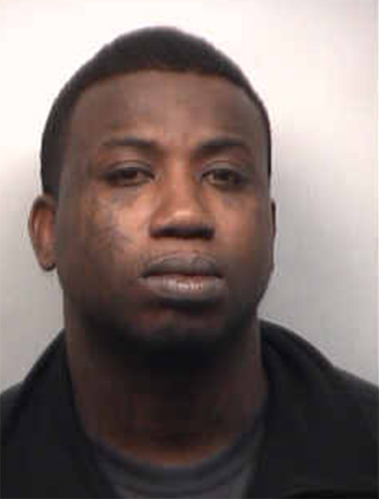 Gucci Mane appears in a mug shot taken by the...
