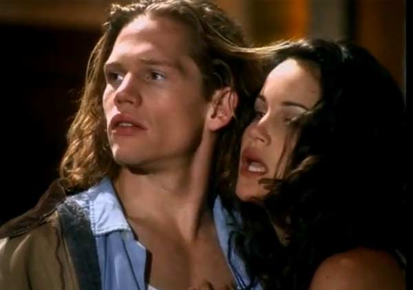 Carla Gugino appears in a scene from the 1994 music video 'Always' alongside Jack Noseworthy.