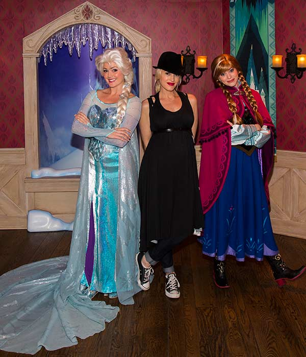 Gwen Stefani meets Anna and Elsa from the new Disney film 'Frozen' at Disneyland park in Anaheim, California on Monday, Nov. 25, 2013.
