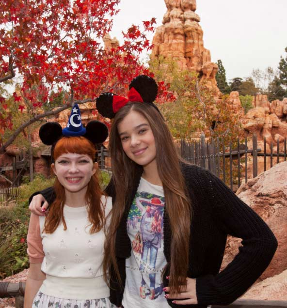 'True Grit' actress Hailee Steinfeld (left) and fashion blogger Tavi Gevinson stand in front of Big Thunder Mountain Railroad at Disneyland park in Anaheim, California, on Thursday, Nov. 10, 2011.