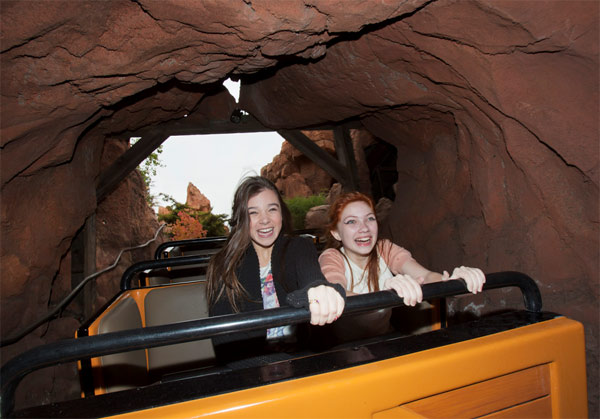 'True Grit' actress Hailee Steinfeld (left) and fashion blogger Tavi Gevinson ride Big Thunder Mountain Railroad at Disneyland park in Anaheim, California, on Thursday, Nov. 10, 2011.