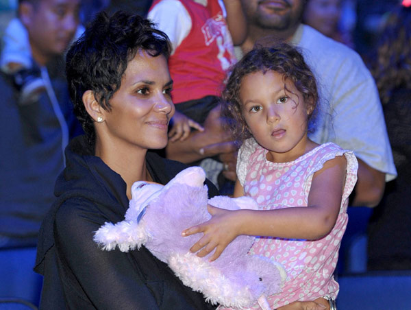 Halle Berry, left, and daughter Nahla Aubry attend attend 'Yo Gabba Gabba! Live!: Get The Sillies Out!' 50+ city tour kick-off performance on Thanksgiving weekend at the Nokia Theatre L.A. Live on Nov. 23, 2012 in Los Angeles.
