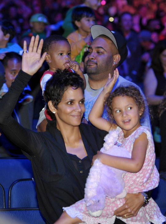 Halle Berry, left, and daughter Nahla attend the 'Yo Gabba Gabba! Live!: Get The Sillies Out!' 50+ city tour kick-off performance on Thanksgiving weekend at the Nokia Theatre L.A. Live on Nov. 23, 2012 in Los Angeles.