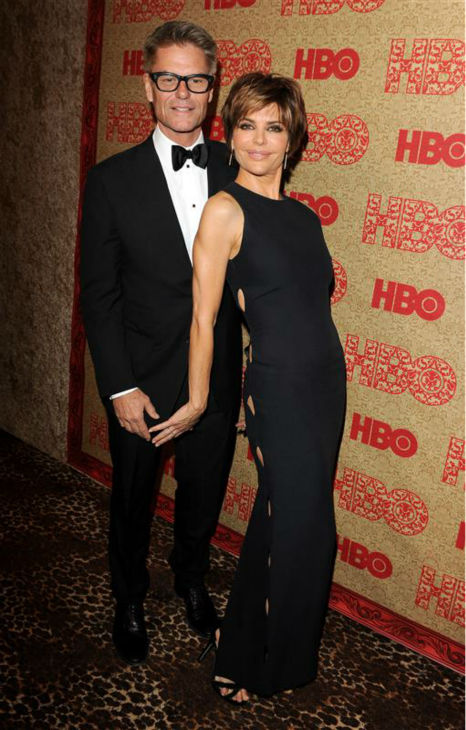 Lisa Rinna appears with husband and fellow actor Harry Hamlin at HBO&#39;s 2014 Golden Globe Awards after party at the Circa 55 restaurant in Beverly Hills, California on Jan. 12, 2014. <span class=meta>(Tony DiMaio &#47; Startraksphoto.com)</span>