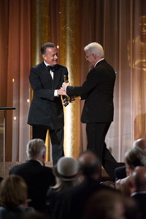 Oscar-winning actor Tom Hanks &#40;left&#41; presents the Oscar to Honorary Award recipient Steve Martin during the 2013 Governors Awards at The Ray Dolby Ballroom in Hollywood, California on Saturday, Nov. 16, 2013. <span class=meta>(Michael Yada &#47; A.M.P.A.S.)</span>