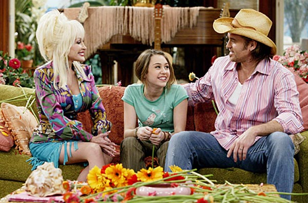 Dolly Parton is Miley Cyrus&#39; grandmother. MYTH: Dolly Parton is Cyrus&#39; godmother. However, there is no blood relation between the two. Pictured: Dolly Parton, Miley Cyrus and Billy Ray Cyrus on an episode of &#39;Hannah Montana.&#39; <span class=meta>(Disney Channel)</span>