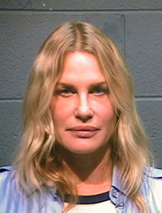 <b>Daryl Hannah appears in a booking photo after...
