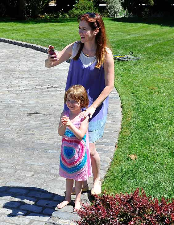 "<div class=""meta image-caption""><div class=""origin-logo origin-image ""><span></span></div><span class=""caption-text"">'How I Met Your Mother' star Alyson Hannigan and daughter Satyana are seen at the Course Of The Force 2013, an 'Epic Lightsaber Relay,' benefiting the Make-A-Wish Foundation, at 'Star Wars' creator George Lucas' Skywalker Ranch in California on July 9, 2013. (Steve Jennings / WireImage)</span></div>"