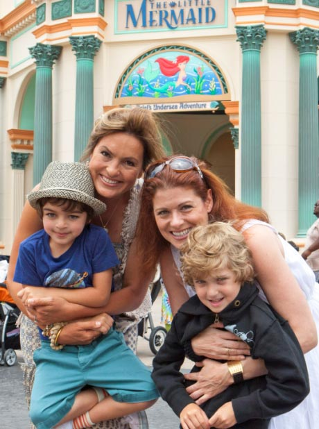 Mariska Hargitay and her son August join Debra Messing and her son, Roman, 7, at the new attraction, 'The Little Mermaid - Ariel's Undersea Adventure', at Disney California Adventure park in Anaheim, Calif., on Wednesday, June 8, 2011.