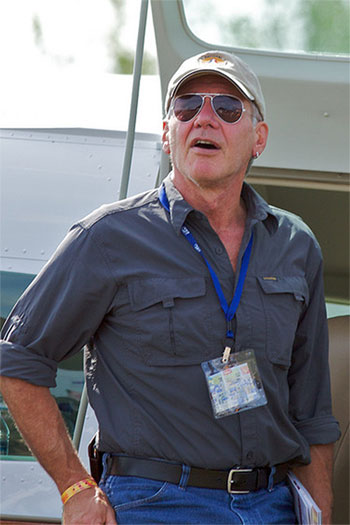 Harrison Ford appears in a photo watching the air show in front of a Cessna Caravan at Airventure day four in July 2009.