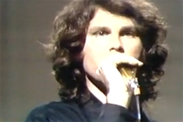 Jim Morrison of The Doors performing in a...