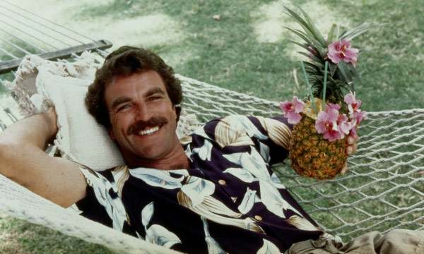 Tom Selleck appears in a scene from the 1980 television show 'Magnum P.I.'