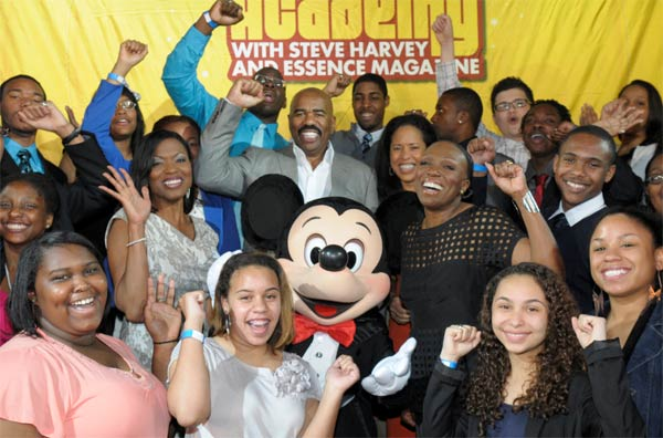 Steve Harvey and high school students pose with Mickey Mouse at Walt Disney World at Lake Buena Vista, Florida on March 11, 2012.
