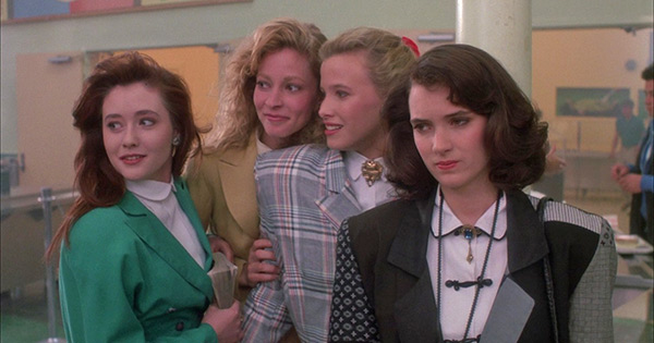 L-R: Shannen Doherty &#40;Heather Duke&#41;, Lisanne Falk &#40;Heather McNamara&#41; and Kim Walker &#40;Heather Chandler&#41; mock a fellow student as Winona Ryder &#40;Veronica Sawyer&#41; looks on in this a scene from the 1988 movie &#39;Heathers.&#39; <span class=meta>(New World Pictures &#47; Anchor Bay Entertainment)</span>