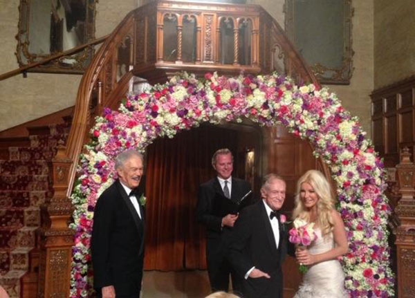 Hugh Hefner posted on Twitter this photo of himself with bride Crystal Harris, along with his brother, Keith, and an officiant at their wedding at the Playboy Mansion on Dec. 31, 2012. &#39;Crystal and I married on New Year&#39;s Eve in the Mansion with Keith as my Best Man. Love that girl!&#39; Hefner Tweeted. <span class=meta>(twitter.com&#47;hughhefner&#47;status&#47;286008201080623104)</span>