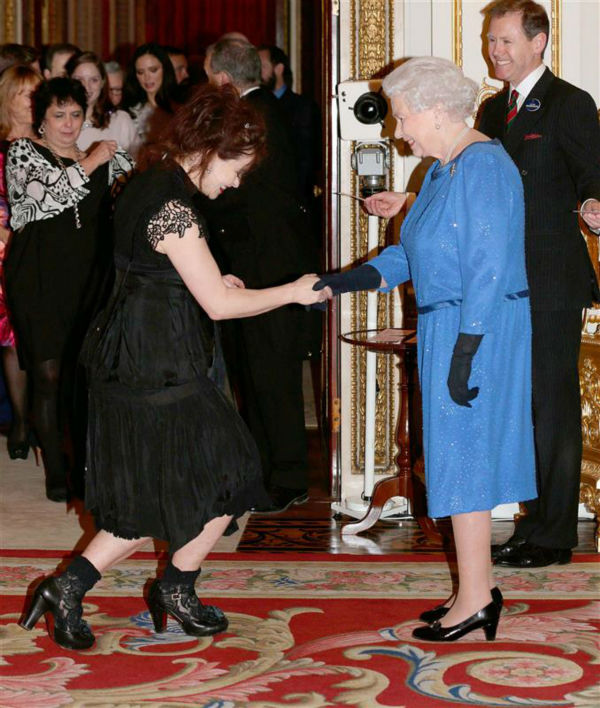 Helena Bonham Carter curtseys to Queen Elizabeth II at the Reception for the Dramatic Arts at Buckingham Palace on Feb. 17, 2014. <span class=meta>(Rex Features &#47; Startraksphoto.com)</span>