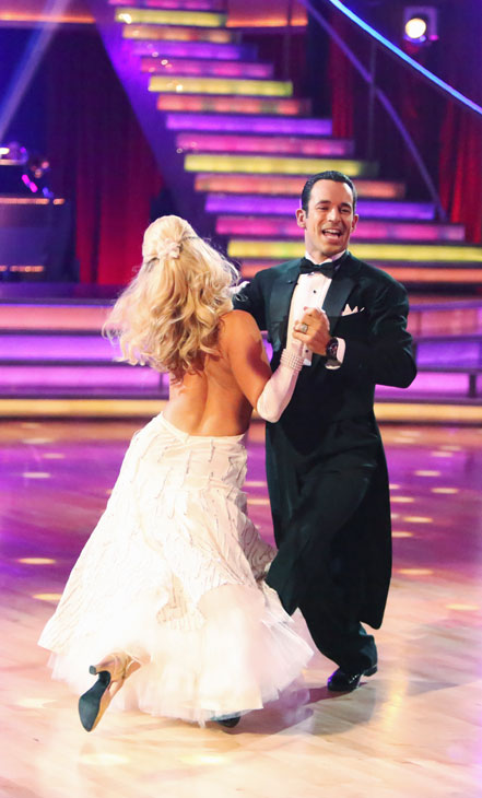 Helio Castroneves and Chelsie Hightower appear in a still from 'Dancing