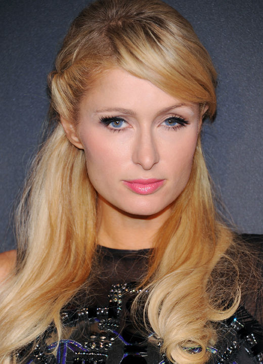 Television personality Paris Hilton arrives at a...