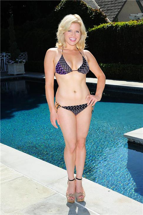Megan Hilty, who played Ivy on NBC's 'Smash,' poses in a bikini near a pool in Los angeles on Sept. 11, 2013.