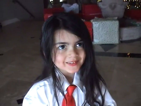 Michael Jackson&#39;s youngest child, son Blanket, stands in front of a Christmas tree and presents in this scene from an undated home video. In the clip, the singer, who is behind the camera, asks him and his siblings, Prince and Paris, what they want to do when they grow up. The video was played during his wrongful death trial in Los Angeles on June 26, 2013. His family is suing concert promoter AEG Live. <span class=meta>(OTRC &#47; Official trial exhibit - Los Angeles Superior Court)</span>