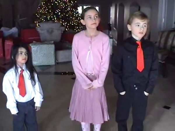 Michael Jackson&#39;s children, Blanket, Paris and Prince, stand in front of a Christmas tree and presents in this scene from an undated home video. In the clip, the singer, who is behind the camera, asks the kids what they want to do when they grow up. The video was played during his wrongful death trial in Los Angeles on June 26, 2013. His family is suing concert promoter AEG Live. <span class=meta>(OTRC &#47; Official trial exhibit - Los Angeles Superior Court)</span>